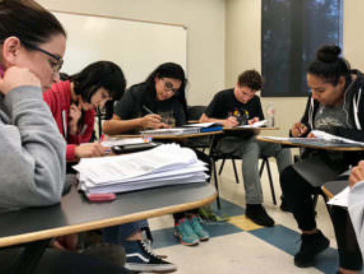 a group of students working together in class